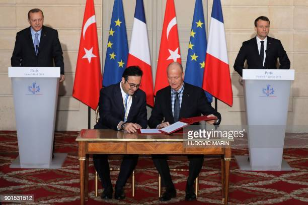 French President Emmanuel Macron and Turkish President Recep Tayyip Erdogan look on as European aircraft manufacturer Airbus CEO Tom enders and...
