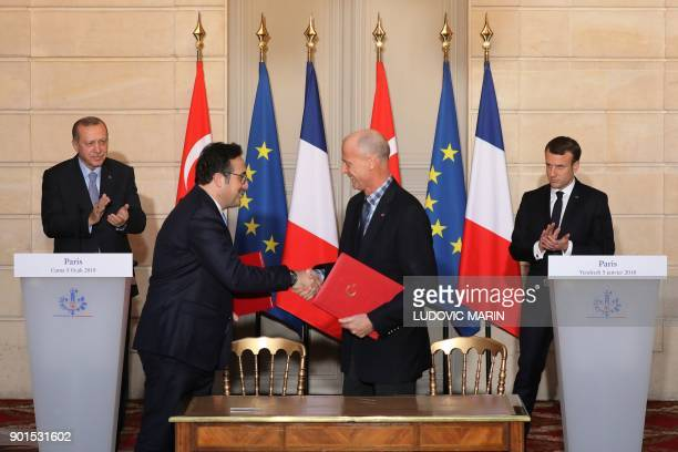French President Emmanuel Macron and Turkish President Recep Tayyip Erdogan applaud as European aircraft manufacturer Airbus CEO Tom enders and...