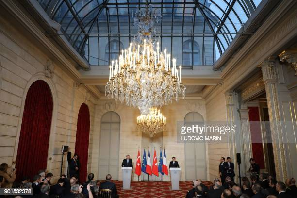 French President Emmanuel Macron and Turkish President Recep Tayyip Erdogan hold a joint press conference on January 5 after their meeting at the...