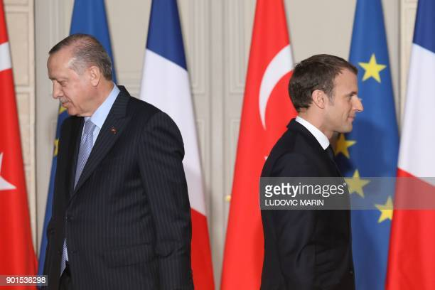 TOPSHOT French President Emmanuel Macron and Turkish President Recep Tayyip Erdogan walk during a joint press conference on January 5 at the Elysee...