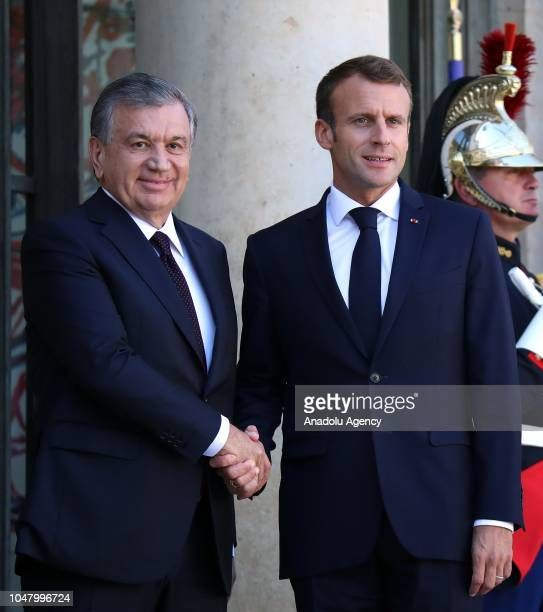 French President Emmanuel Macron and Uzbekistan President Shavkat Mirziyoyev shake their hands ahead of their meeting at the Elysee Palace in Paris...