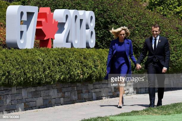 French President Emmanuel Macron and wife Brigitte Macron arrive for the G7 official welcome at Le Manoir Richelieu on day one of the G7 meeting on...