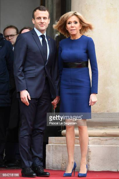 French President Emmanuel Macron and wife Brigitte Macron pose in the courtyard of Elysee Palace on March 19, 2018 in Paris, France. Grand-Duke Henri...