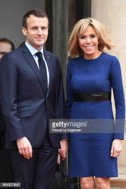 French President Emmanuel Macron and wife Brigitte Macron pose in the courtyard of Elysee Palace on March 19 2018 in Paris France GrandDuke Henri Of...