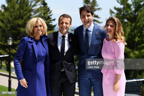 French President Emmanuel Macron and wife Brigitte Macron pose with Prime Minister of Canada Justin Trudeau and wife Sophie Gregoire during the G7...