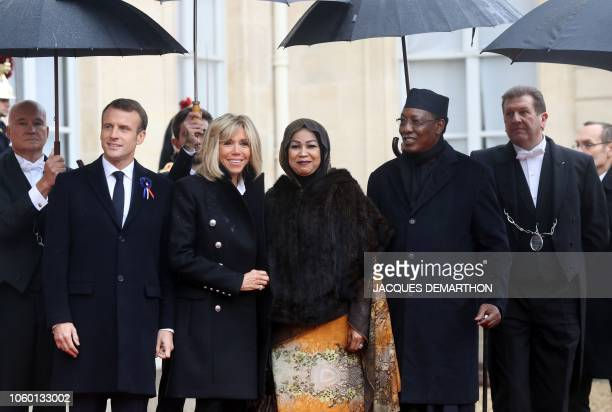French President Emmanuel Macron and wife Brigitte Macron welcome Tchad's President Idriss Deby and his wife Hinda Deby Itno as they arrive at the...