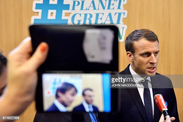 French President Emmanuel Macron answers journalists' questions at the French stand during the UN conference on climate change on November 15 2017 in...
