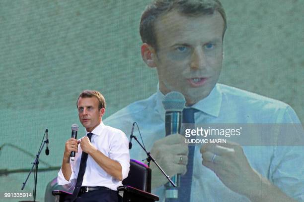 French President Emmanuel Macron answers questions during a live interview on Trace tv in the Afrika Shrine in Lagos on July 3 2018 French President...