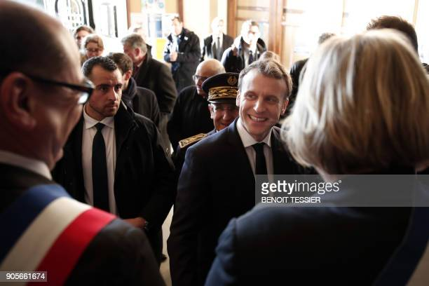 French President Emmanuel Macron arrives at the Calais' townhall northern France for a meeting with mayor of Calais on January 16 2018 French...