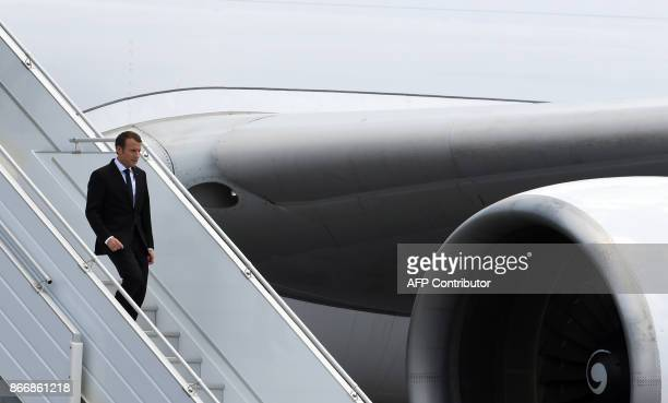 TOPSHOT French president Emmanuel Macron arrives at the Felix Eboue airport in Cayenne on October 26 2017 Macron arrived on October 26 for a 48hour...