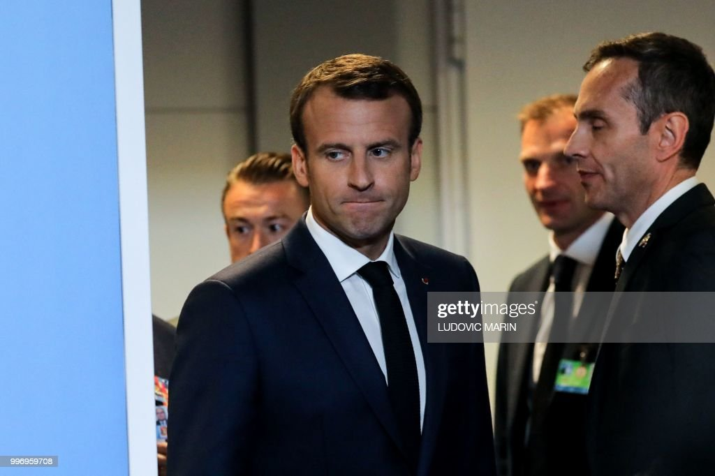 TOPSHOT - French President Emmanuel Macron (L) arrives for a press conference on the second day of the North Atlantic Treaty Organization (NATO) summit in Brussels on July 12, 2018.