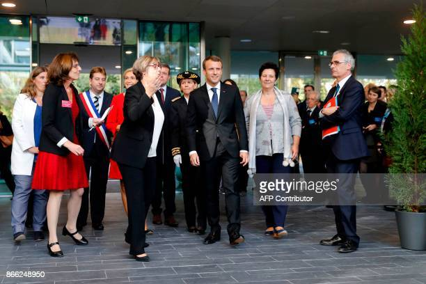 French President Emmanuel Macron arrives for the inauguration of the Institute of Mathematics with President of the ParisSud University Sylvie...