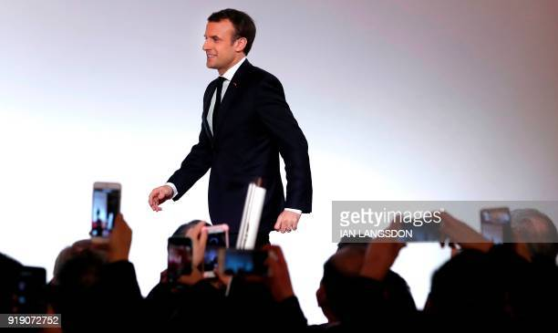 French president Emmanuel Macron arrives on stage to deliver a speech to members of France's Chinese community during the Chinese New Year...