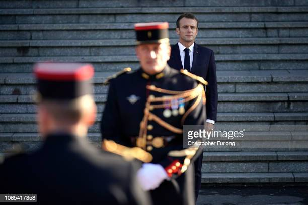French President Emmanuel Macron arrives on the steps of Albert Town Hall for a meeting with British Prime Minister Theresa May in the region which...