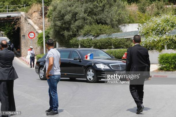 French President Emmanuel Macron arrives to attend the funeral of late Tunisian President Beji Caid Essebsi at the Carthage Presidential Palace in...