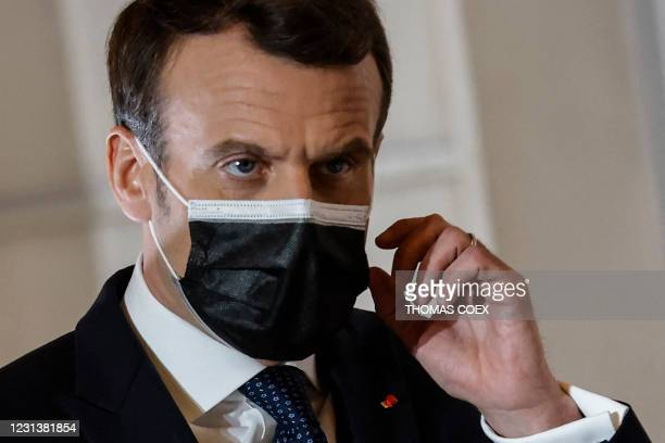 French President Emmanuel Macron arrives to deliver a press conference after a European Council summit held over video-conference, on February 25 at...