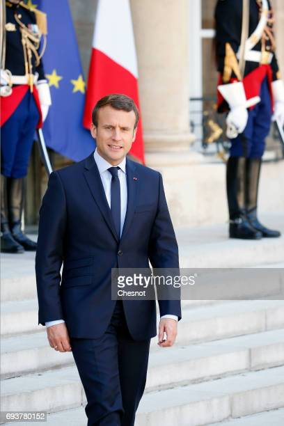 French President Emmanuel Macron arrives to make a statement with Peruvian President Pedro Pablo Kuczynski during a press conference after their...