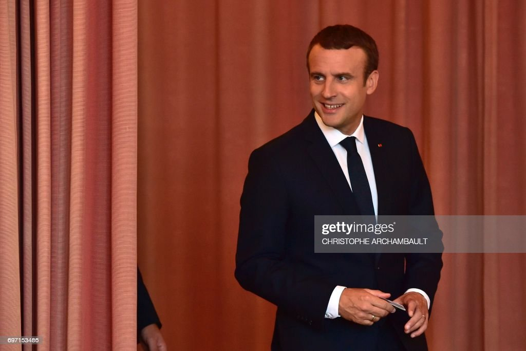 French President Emmanuel Macron arrives to vote at a polling station in Le Touquet, northern France, during the second round of the French parliamentary elections (elections legislatives in French), on June 18, 2017. /