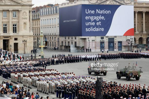 French President Emmanuel Macron arrives with Chief of the Defence Staff General Francois Lecointre prior to the annual Bastille Day military...