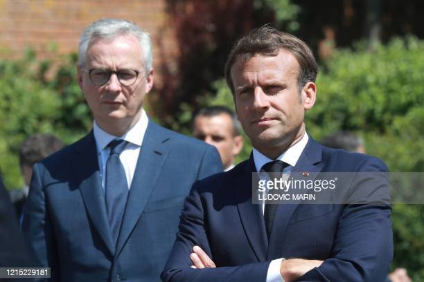 French President Emmanuel Macron arrives with French Economy Minister Bruno Le Maire to visit a factory of manufacturer Valeo in Etaples, near Le...