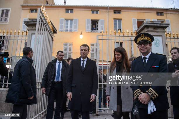 French President Emmanuel Macron arrives with French Junior Minister for Gender Equality Marlene Schiappa and prefect of Corsica Bernard Schmeltz to...