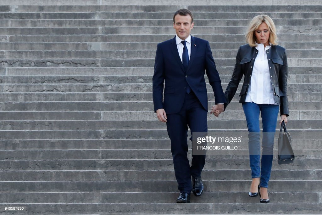French President Emmanuel Macron L Arrives With His Wife Brigitte Macron To Attend An