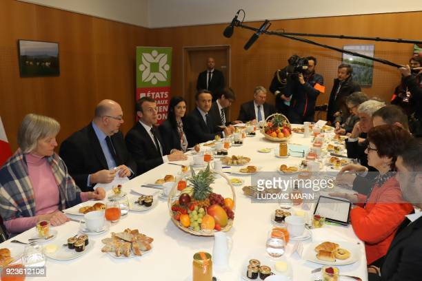 French President Emmanuel Macron attends a breakfast with agricultural unions and chambers flanked by French Agriculture Minister Stéphane Travert...