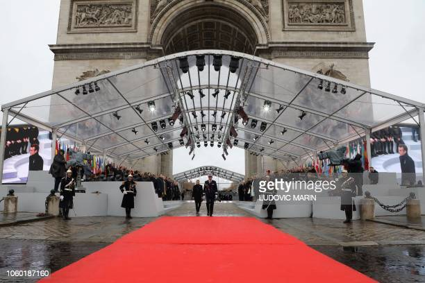 French President Emmanuel Macron attends a ceremony at the Arc de Triomphe in Paris on November 11, 2018 as part of commemorations marking the 100th...