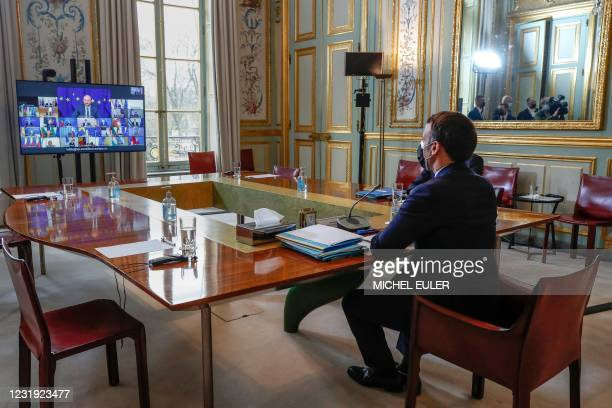French President Emmanuel Macron attends a European Union summit over video conference with the EU leaders at the Elysee Palace in Paris, on March...