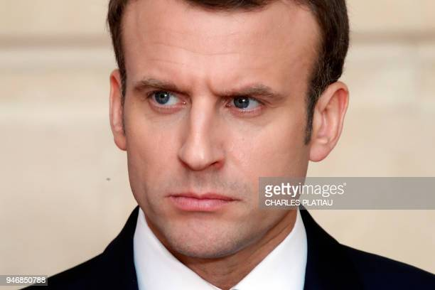 French President Emmanuel Macron attends a joint news conference with New Zealand's Prime Minister at the Elysee Palace in Paris on April 16 2018 /...