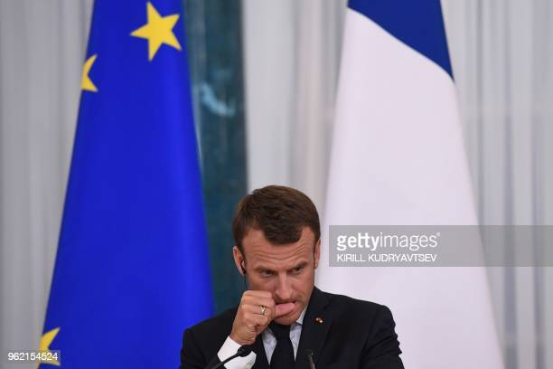 French President Emmanuel Macron attends a joint press conference with his Russian counterpart following their talks at the Konstantin Palace in...