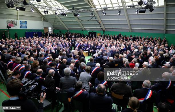 TOPSHOT French President Emmanuel Macron attends a meeting gathering some 600 mayors who will relay the concerns aired by residents in their towns...