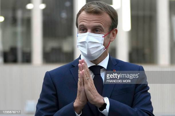 French President Emmanuel Macron attends a meeting with staff members at the headquarters of the Paris 2024 Organising Committee for the Olympic and...