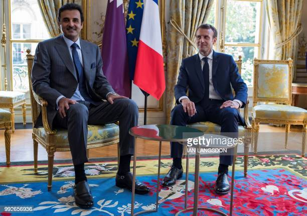 French President Emmanuel Macron attends a meeting with the Emir of Qatar Sheikh Tamim bin Hamad Al Thani at the Elysee Presidential Palace in Paris...