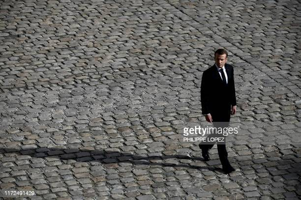 French President Emmanuel Macron attends a military tribute to former French President Jacques Chirac at the Invalides in Paris on September 30,...