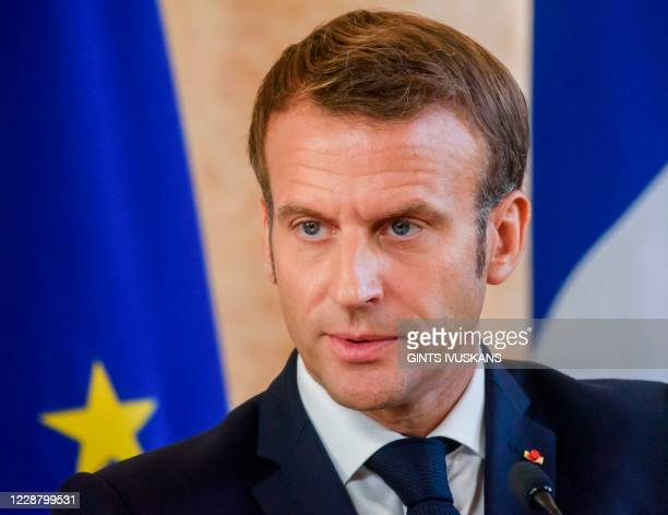 French President Emmanuel Macron attends a press conference with Latvia's Prime Minister after their meeting on September 30, 2020 in Riga, Latvia,...