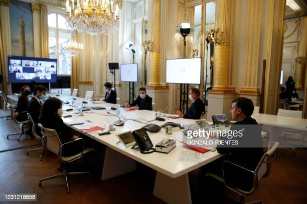 French President Emmanuel Macron attends a video conference meeting with African Union officials following the ACT-A initiative to coordinate a...