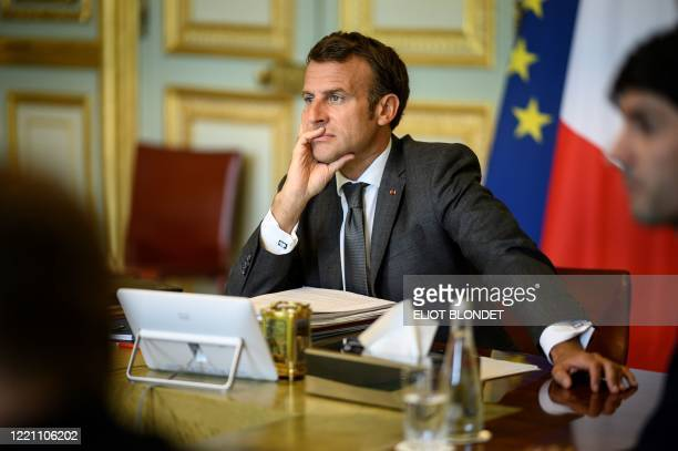 French President Emmanuel Macron attends an European Council meeting by videoconference on economic rescue plan from the Elysee Palace, in Paris, on...