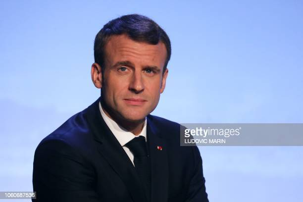 French President Emmanuel Macron attends the opening session of the Internet Governance Forum at the UNESCO headquaters in Paris on November 12 2018...