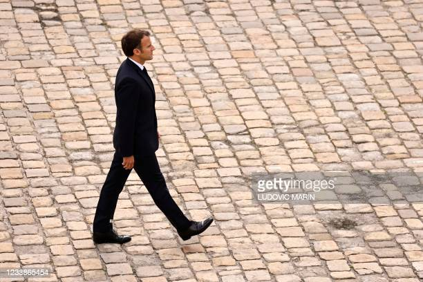 """French President Emmanuel Macron attends the """"prise d'armes"""" military ceremony in the courtyard of the Invalides, in Paris on July 8, 2021."""