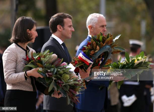 French President Emmanuel Macron Australian Prime Minister Malcolm Turnbull and New South Wales state Premier Gladys Berejiklian place wreaths during...