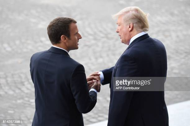 French President Emmanuel Macron bids farewell to his US counterpart Donald Trump after the annual Bastille Day military parade on the ChampsElysees...
