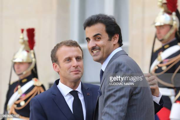 French President Emmanuel Macron bids farewell to Qatar Sheikh Tamim bin Hamad Al Thani at the Elysee palace for a meeting with French president on...