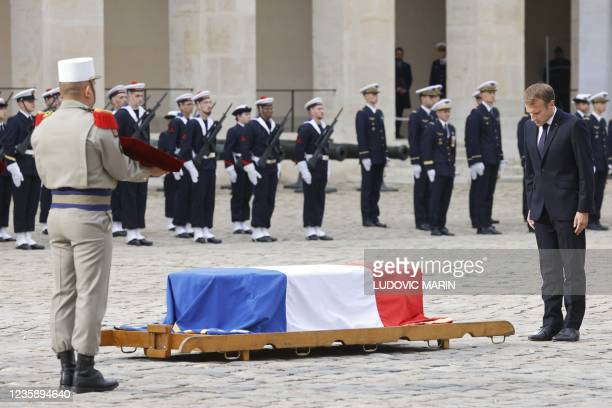 French President Emmanuel Macron bows in front of the coffin during a national memorial service for Hubert Germain - the last surviving Liberation...
