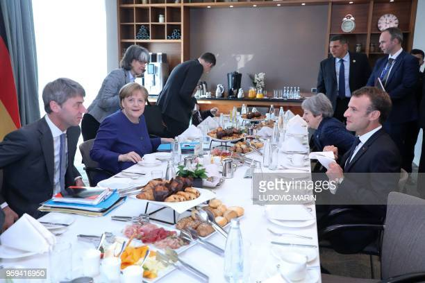 French President Emmanuel Macron British Prime Minister Theresa May and German Chancellor Angela Merkel attend a breakfast meeting at the start of an...