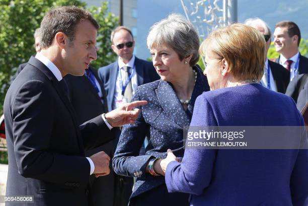 French President Emmanuel Macron British Prime Minister Theresa May and German Chancellor Angela Merkel speak following a trilateral meeting on the...