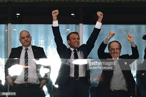 French President Emmanuel Macron celebrates alongside French Football Federation president Noel Le Graet and FIFA President Gianni Infantino the end...