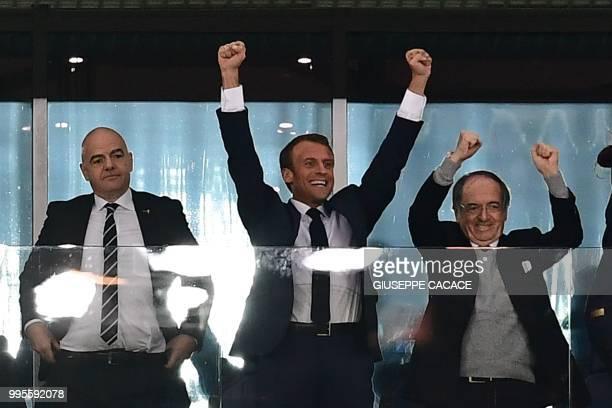 French President Emmanuel Macron celebrates alongside French Football Federation president Noel Le Graet and FIFA President Gianni Infantino the end...
