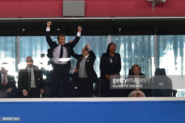French President Emmanuel Macron celebrates alongside French Football Federation president Noel Le Graet and French Sports Minister Laura Flessel at...
