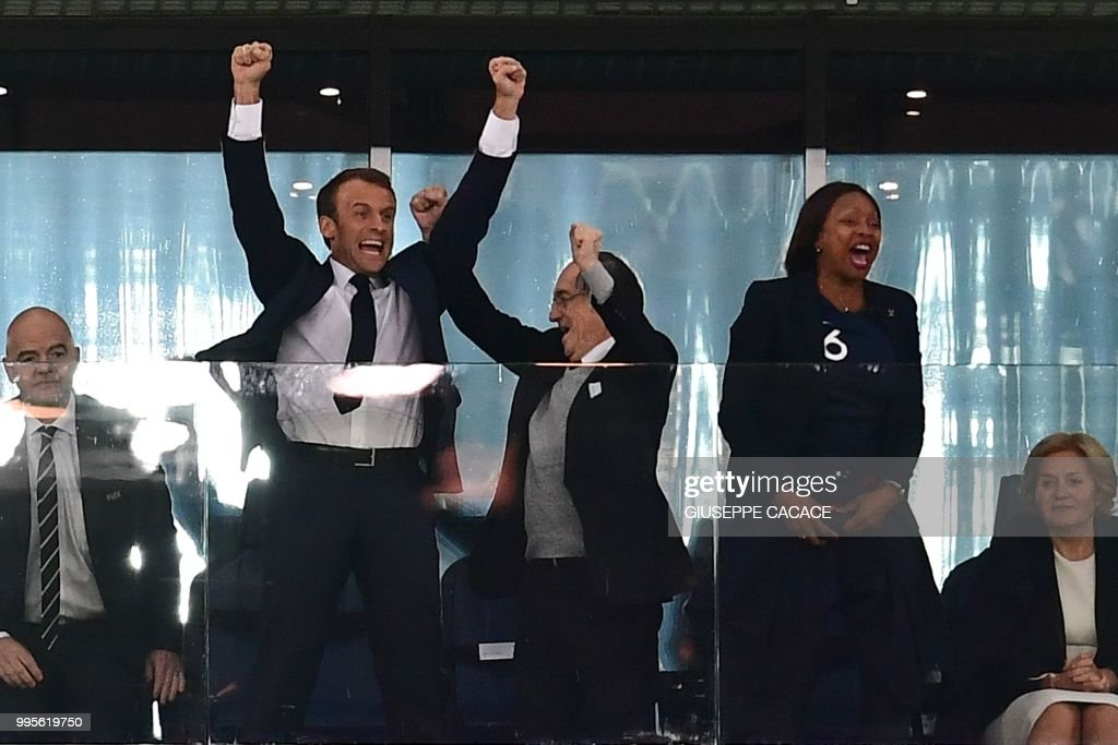 TOPSHOT - French President Emmanuel Macron (C-L) celebrates, alongside French Football Federation (FFF) president Noel Le Graet (C) and French Sports Minister Laura Flessel (C-R), at the end of the Russia 2018 World Cup semi-final football match between France and Belgium at the Saint Petersburg Stadium in Saint Petersburg on July 10, 2018. - France reached the World Cup final on Tuesday after a second-half header from Samuel Umtiti gave them a 1-0 win against Belgium. (Photo by Giuseppe CACACE / AFP) / RESTRICTED